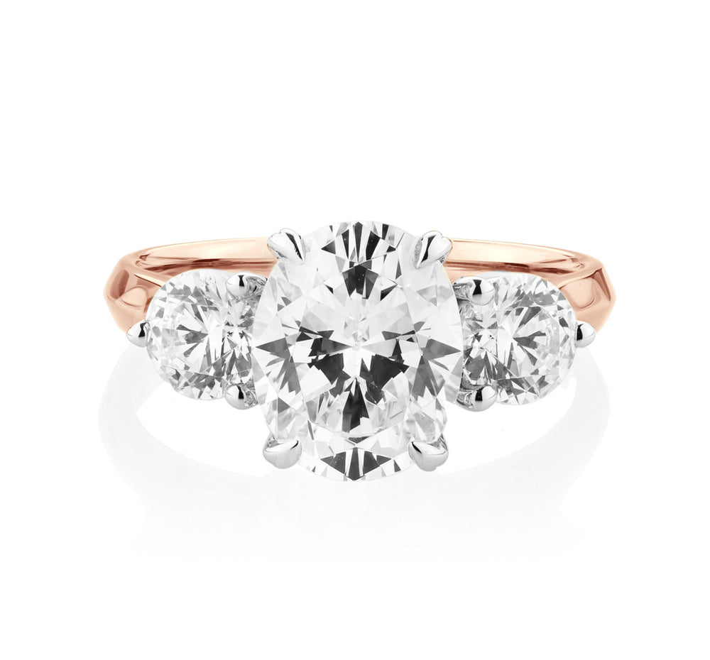 3 Stone Oval and Round Brilliant Knife Edge Ring in 10ct Rose Gold with White Gold Setting