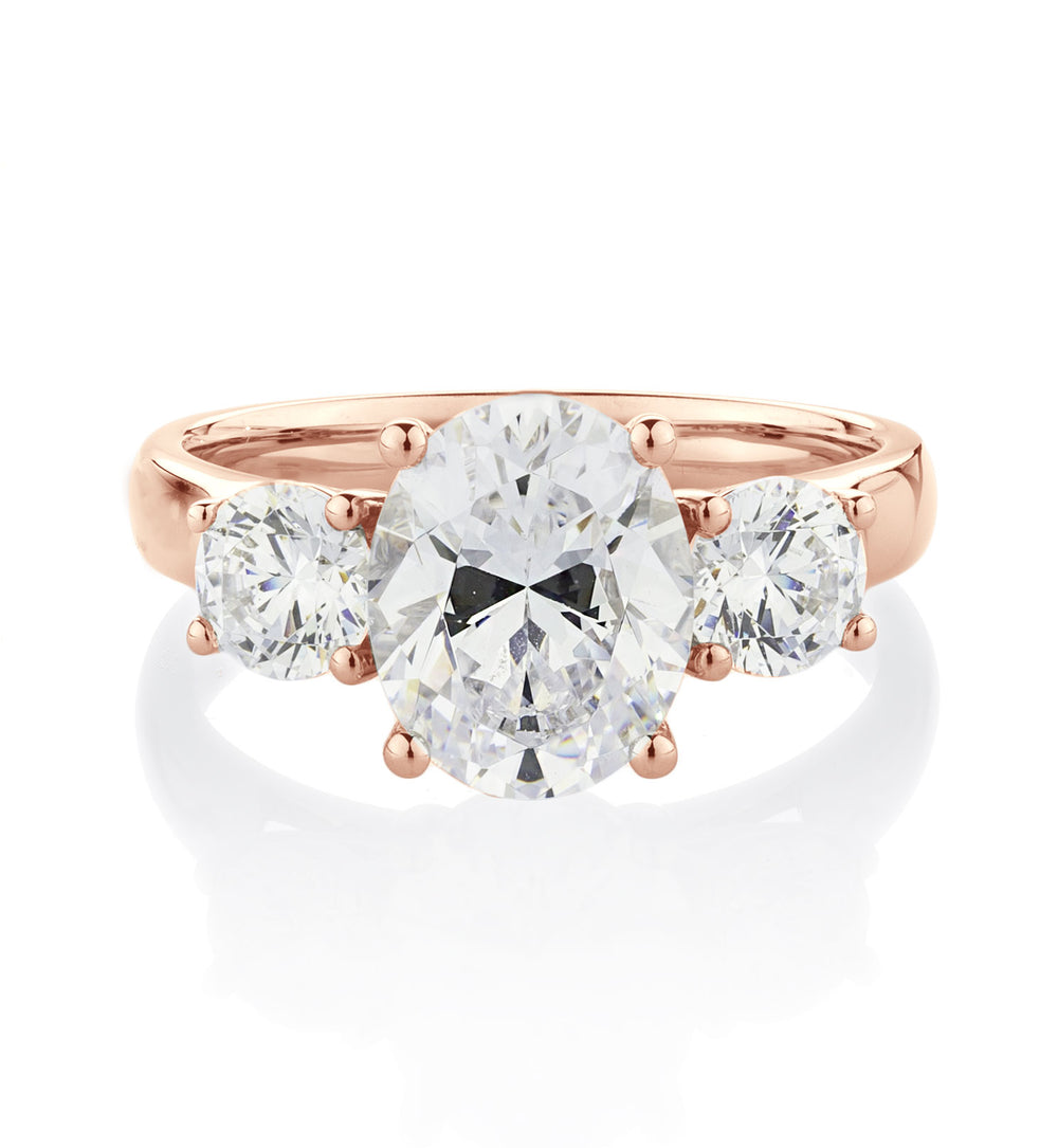 3 Stone Oval and Round Brilliant Claw Set Ring in 10ct Rose Gold