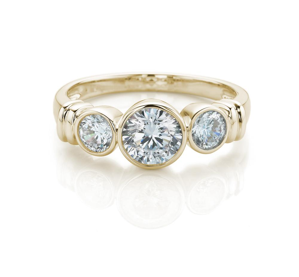 3 Stone Bezel Set With Side Detail Ring in Yellow Gold