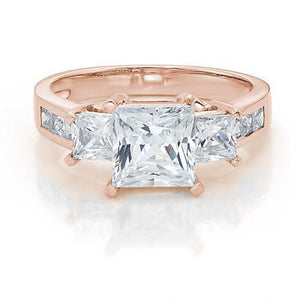 Three Stone Princess Cut Ring with Side Stones in Rose Gold