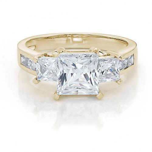 Three Stone Princess Cut Ring with Side Stones in Yellow Gold