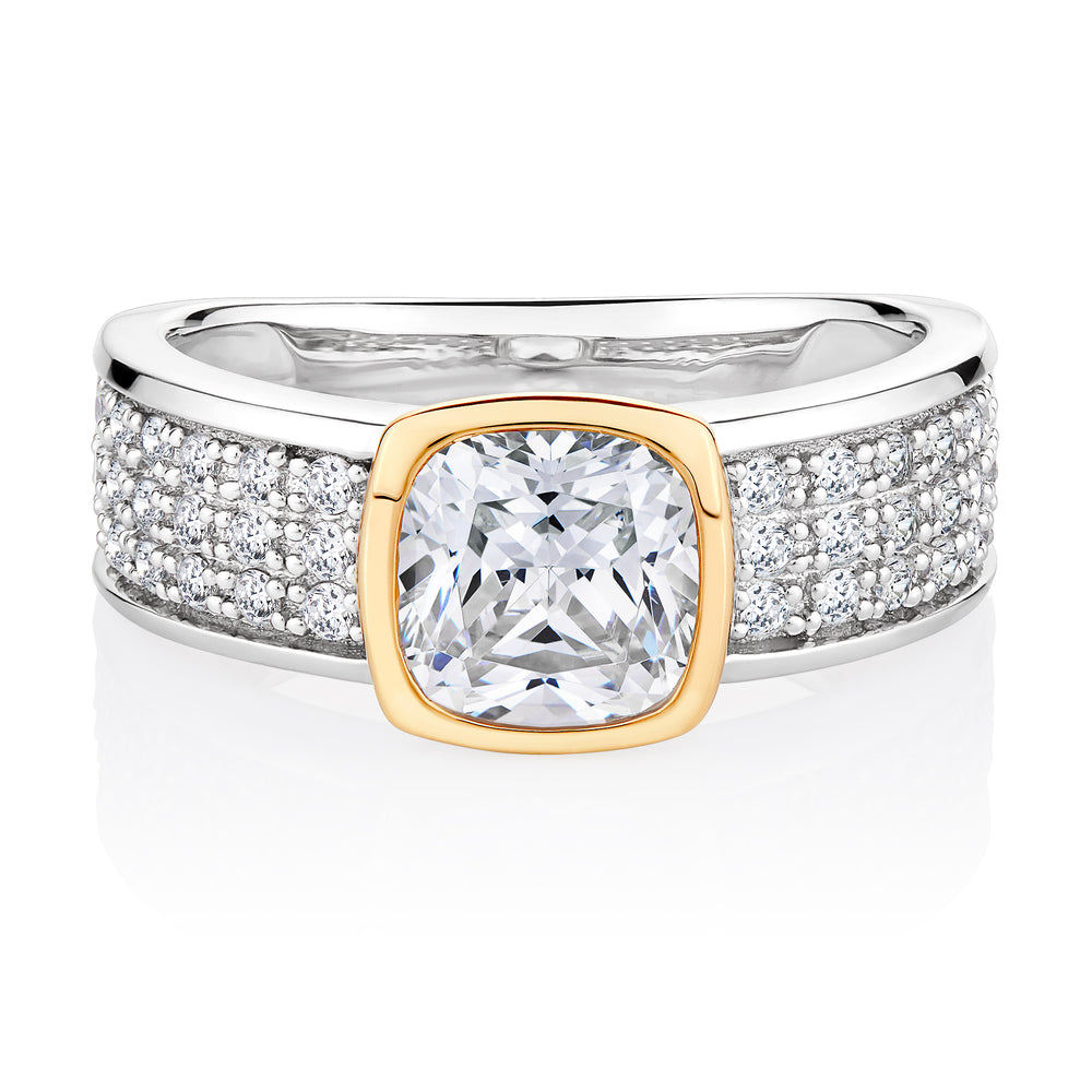 Synergy cushion and round brilliant cut diamond simulant ring crafted in sterling silver with yellow gold