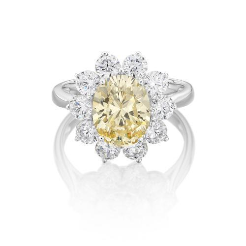 Claw Set Brilliant Oval Cut Ring - Yellow Colour in White Gold