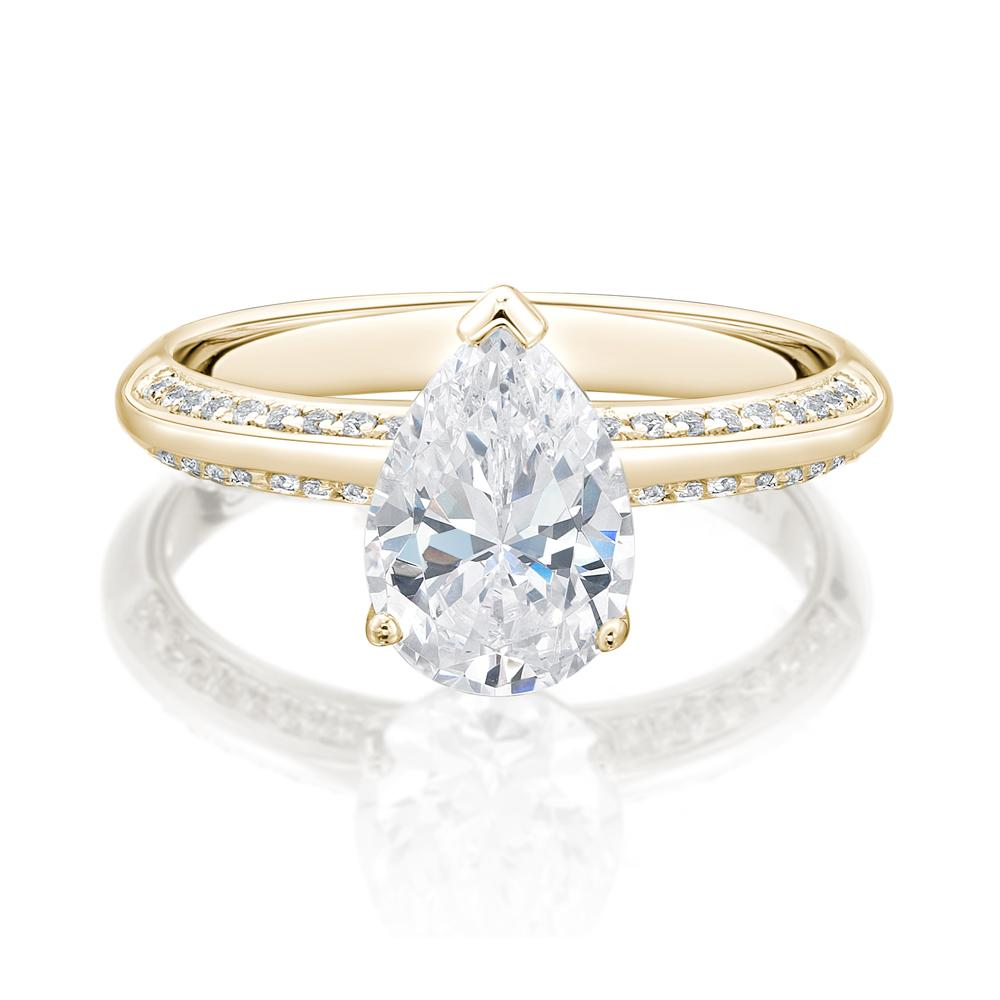 Pear Cut Knife Edge Engagement Ring with Side Stones in Yellow Gold