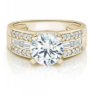 Round Brilliant and Baguette Channel Set Ring in Yellow Gold