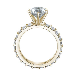 Claw Set Round Brilliant Engagement Ring in Yellow Gold