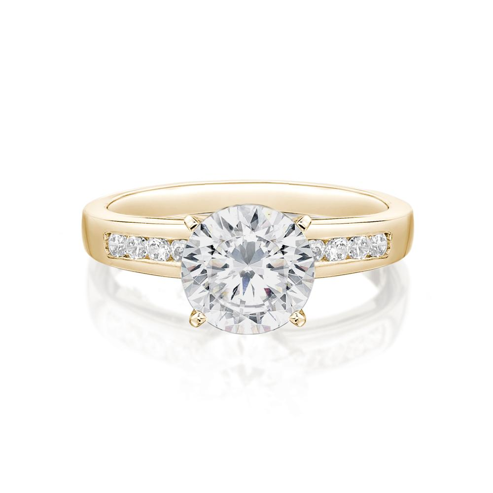 Channel and Claw Set Round Brilliant Engagement Ring in Yellow Gold