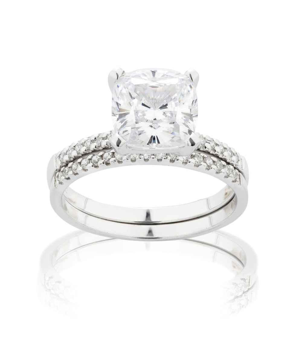Cushion Cut and Round Brilliant Engagement Ring and band set in White Gold
