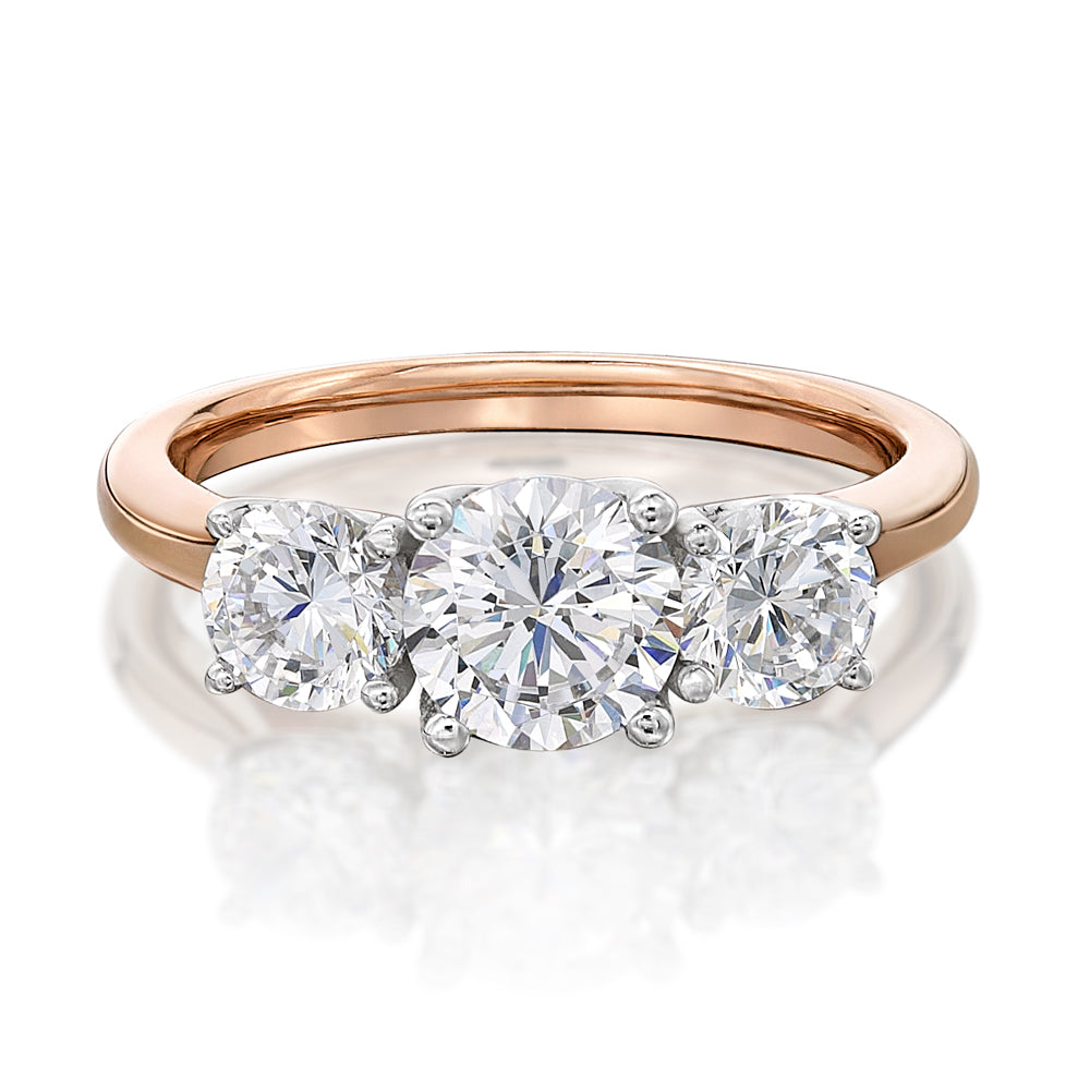 Round Brilliant Cut 3 Stone Trilogy Engagement Ring in Rose Gold
