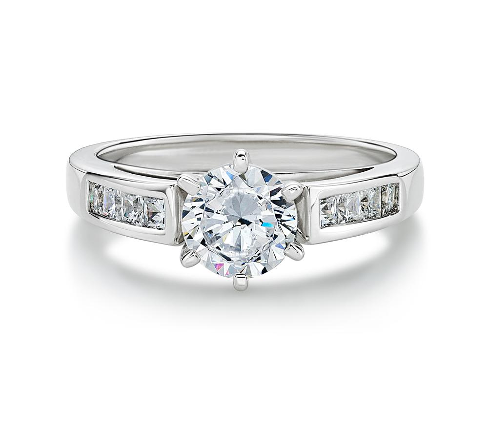 Claw and Channel Set Round Brilliant Engagement Ring in White Gold