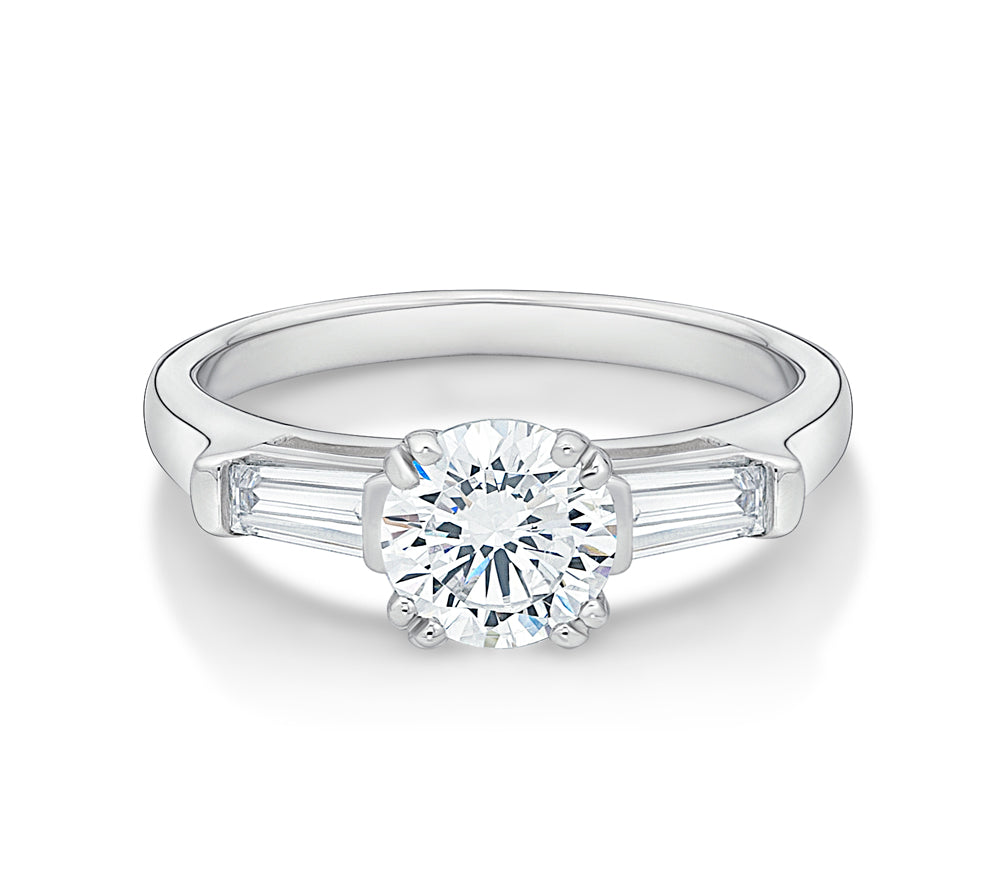 Round Brilliant and Baguette Cut Engagement Ring in White Gold