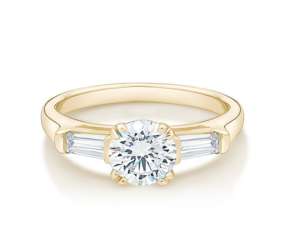 Round Brilliant and Baguette Cut Engagement Ring in Yellow Gold