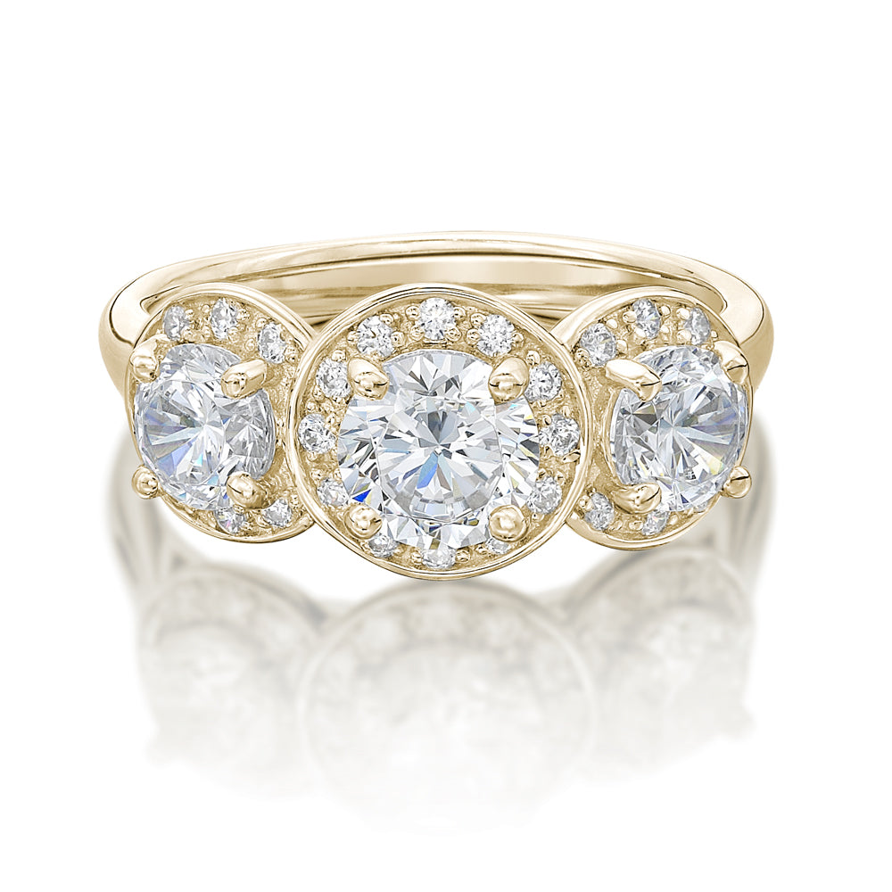 Round Brilliant Cut Halo Three Stone Trilogy Ring in Yellow Gold