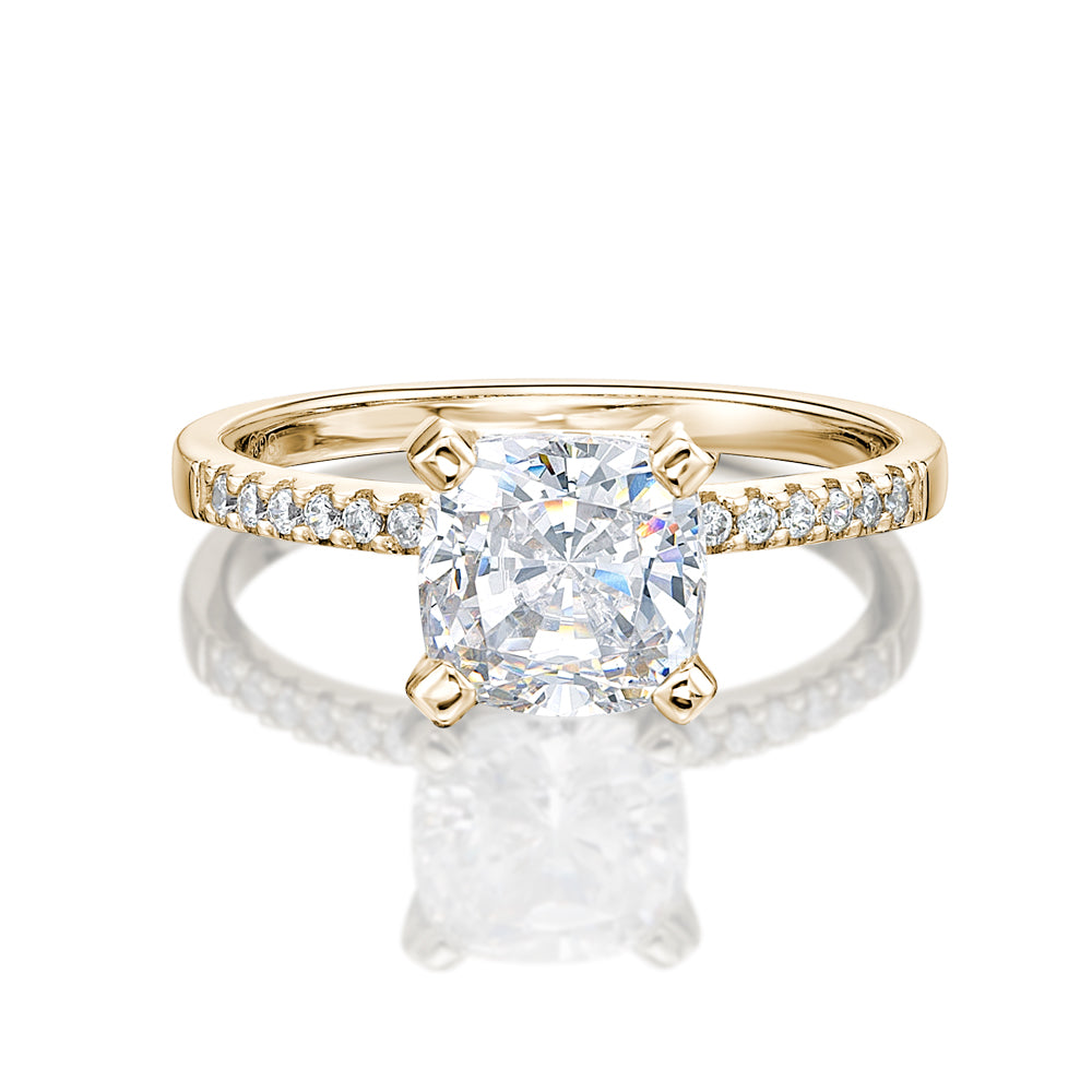 Cushion Cut and Round Brilliant Engagement Ring in Yellow Gold
