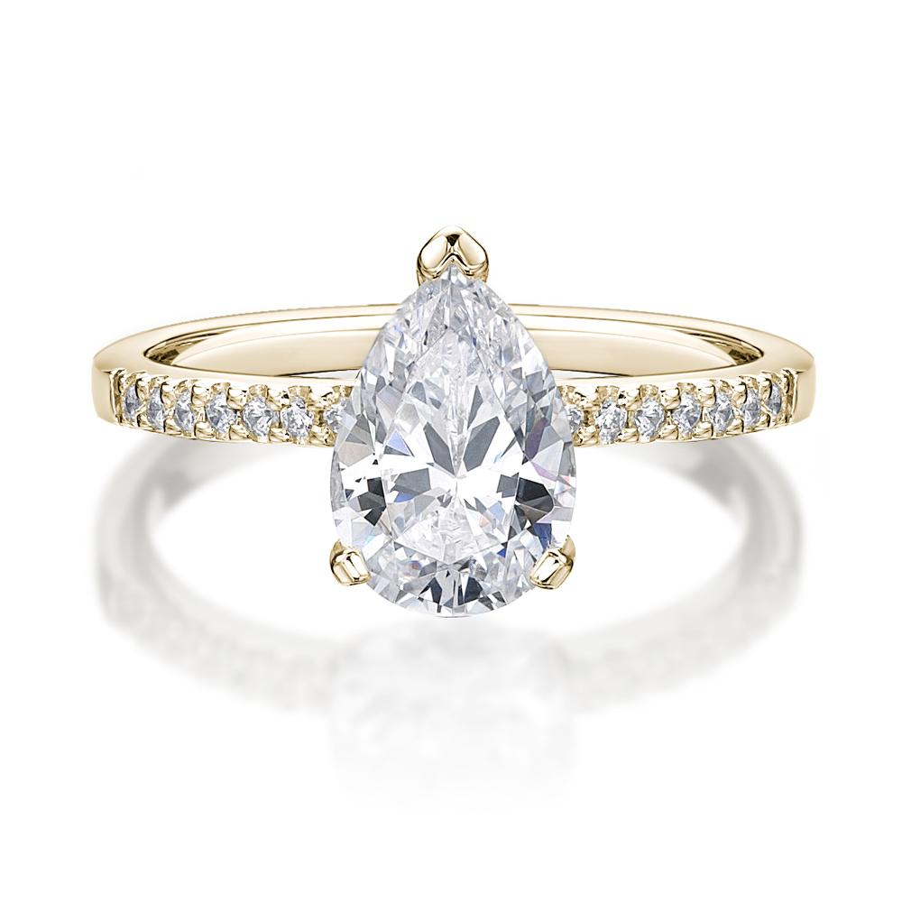 Pear Cut and Round Brilliant Engagement Ring in Yellow Gold