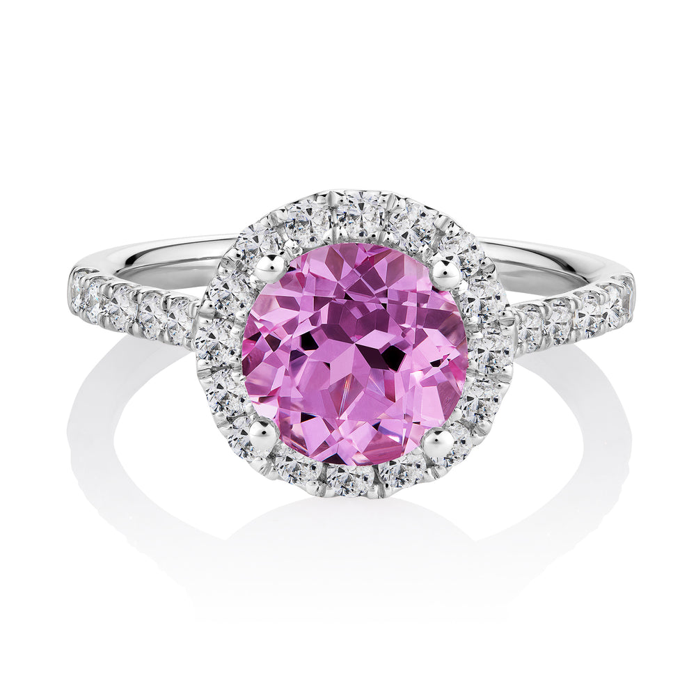 Pink and white round brilliant cut diamond simulant halo ring crafted in white gold