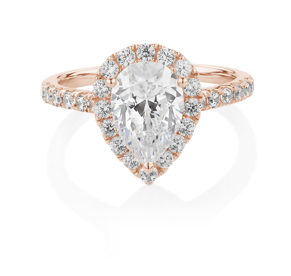 Pear and Round Cut Halo Engagement Ring Rose Gold