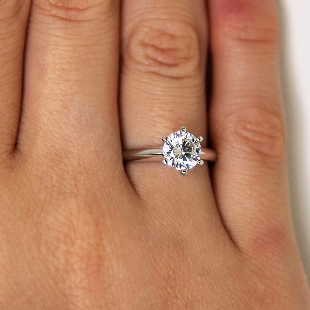 Round Brilliant Cut Solitaire with Knife Edge Band in Yellow Gold with White Gold Setting
