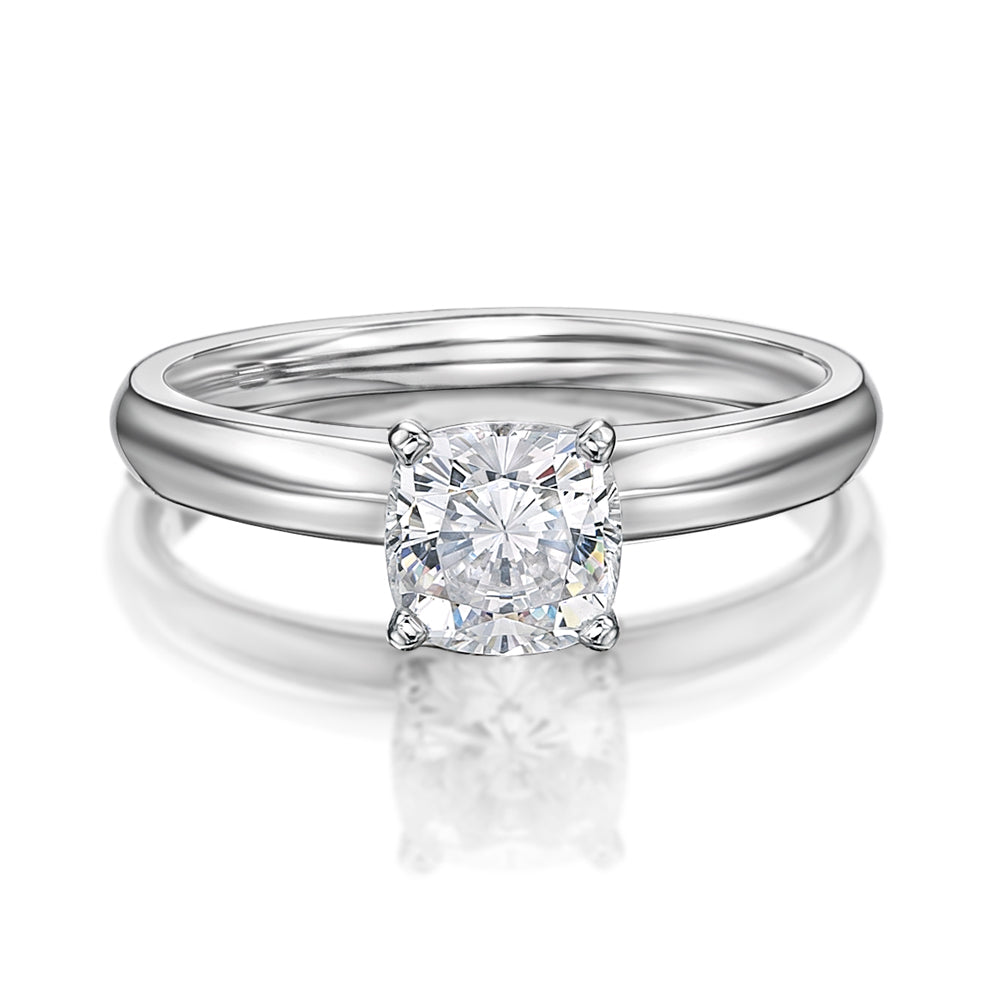 Cushion Cut Solitaire With Knife Edge Band in White Gold