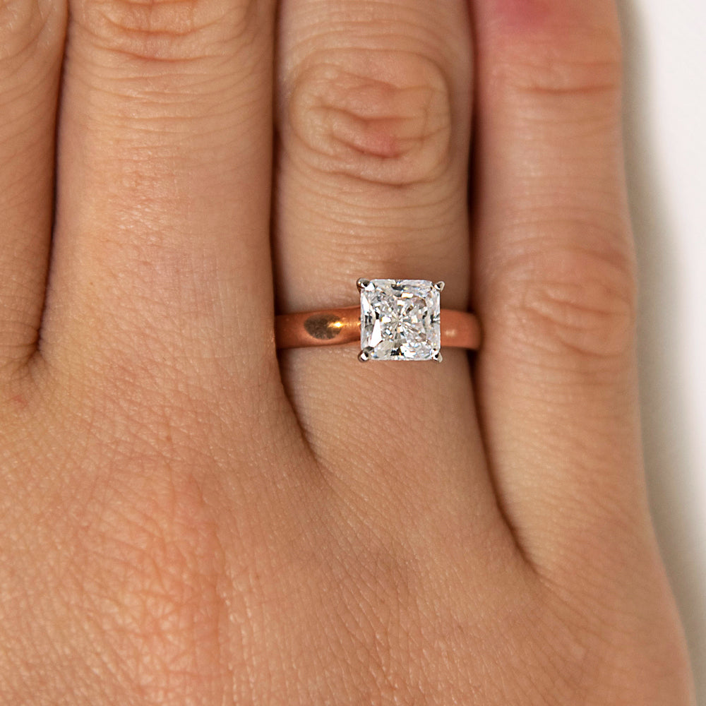 Princess Cut Solitaire With Half Round Band in Rose Gold with White Gold Setting