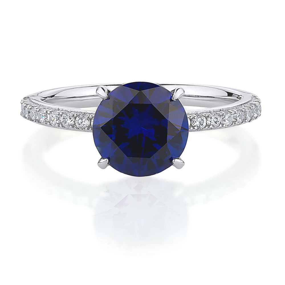 Round Cut Dress Ring with side stones- Sapphire Colour