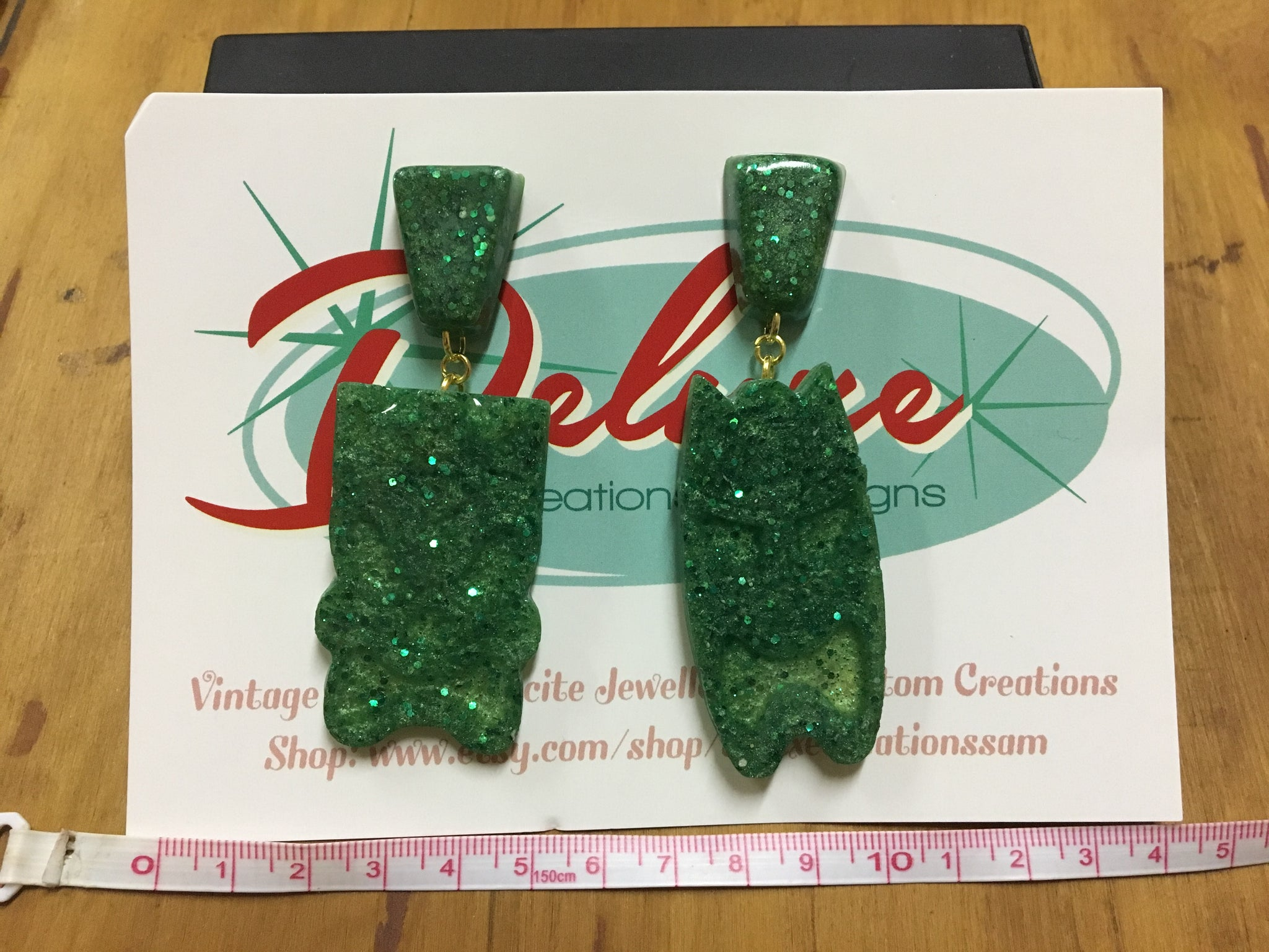 Deluxe creations large green tiki head earrings