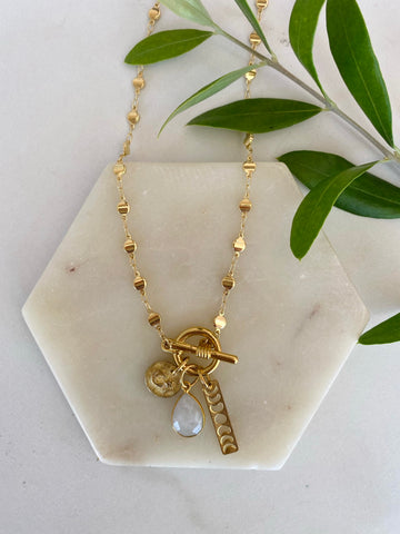 DIY bohemian and popular delicate layering necklace sets in gold, popular 2021 jewelry trends celestial moon and star charm statement starry night necklace