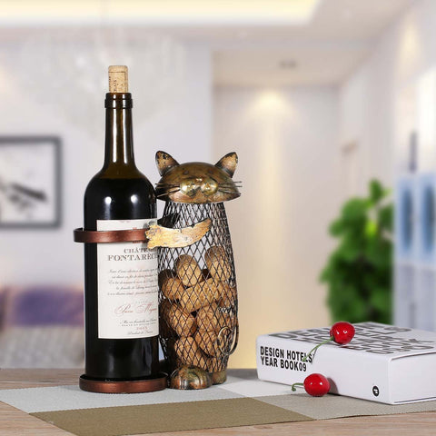 Cat wine holder and netted cork container featuring a cat figurine with gold finish.
