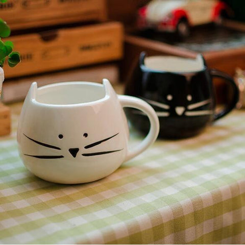 Funny cat mug featuring a cat face and made from dishwasher safe and microwaveable ceramic.
