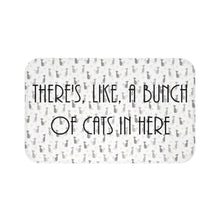 "Load image into Gallery viewer, Cat bath mat featuring the inscription ""There's like a bunch of cats in here"" on a cat print background"