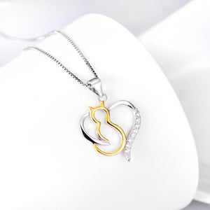 Elegant jewelry for cat lovers made from sterling silver and featuring a two-tone pendant of a gold cat and sterling silver heart.