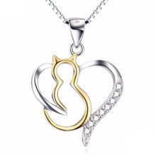 Load image into Gallery viewer, A sterling silver cat necklace featuring a beautiful gold cat pendant inside a crystal encrusted silver heart.