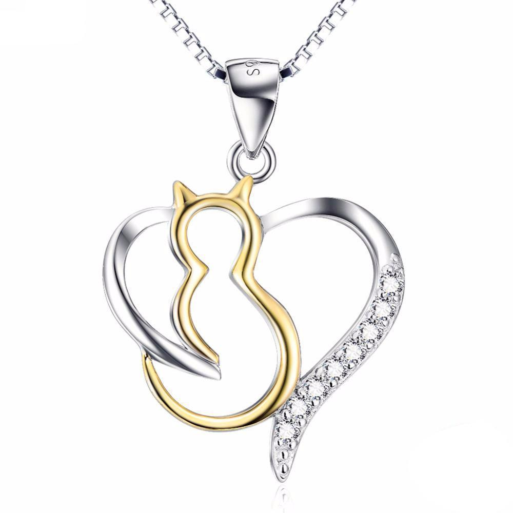 A sterling silver cat necklace featuring a beautiful gold cat pendant inside a crystal encrusted silver heart.
