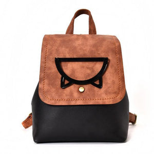 This kitty cat backpack is made from black and brown faux leather and features a metal kitty cat face.