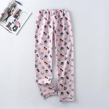 Load image into Gallery viewer, The drawstring pants of these pajamas with cats on them keep you cozy and give you enough stretch to make lounging more comfortable.