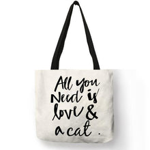 Load image into Gallery viewer, Cool Things for Cat Lovers, Cat Tote Bag with the Words All You Need Is Love and a Cat Printed On the Front