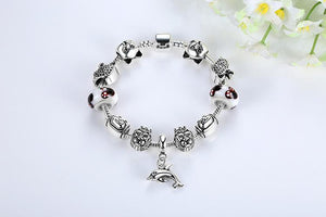 Refresh your cats jewelry collection with this sterling silver cat bracelet with cat shaped charms.
