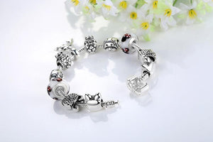This unique cats bracelet is made of sterling silver and features different animal charms as well as a couple of cat charms.