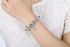 Pick up this silver cat charms bracelet as the best gift for a cat lover that is elegant, cute, and unique.