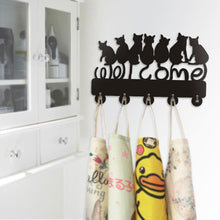 Load image into Gallery viewer, Refresh your black cat home decor with this cute cat hanger featuring 5 hooks for coats and 7 black kitty cats.