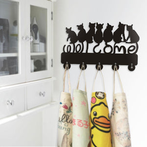 Refresh your black cat home decor with this cute cat hanger featuring 5 hooks for coats and 7 black kitty cats.