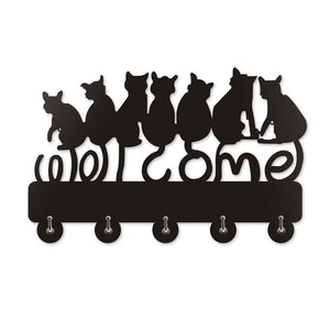 For a fun and functional black cat home decor piece, pick up this black cat coat hanger decorated with 7 black cats and featuring 5 metal hooks.