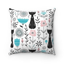 Load image into Gallery viewer, In addition to the unique black cat print, this cute cat pillow also features blue, pink, and black abstract flowers.