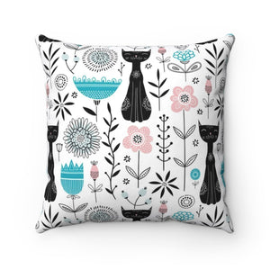In addition to the unique black cat print, this cute cat pillow also features blue, pink, and black abstract flowers.
