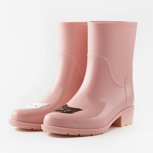 Cat Themed Clothes and Apparel, Cat Rain Boots In Light Pink Color Featuring a Black and a White Cat On the Front