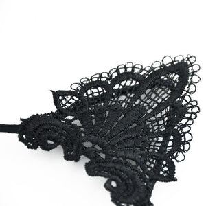 This cat ears headband is decorated with pointy cat ears made from delicate black lace.