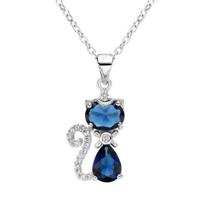 This sterling silver crystal cat pendant necklace features a deep blue crystal cat pendant with a tail and collar that are encrusted with shiny white cubic zirconia.