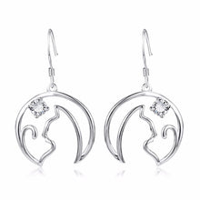 Load image into Gallery viewer, These beautiful cat dangle earrings feature a cat silhouette staring at a shiny crystal star.
