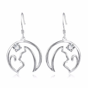 These beautiful cat dangle earrings feature a cat silhouette staring at a shiny crystal star.