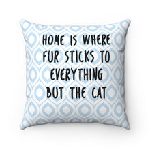 "Load image into Gallery viewer, This decorative cat pillow has the text ""Home is where fur sticks to everything but the cat"" printed in black on a white and blue argyle pattern."